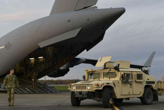 """In this Oct. 31, 2018, photo provided by the U.S. Air Force, Master Sgt. Matt Conn, a loadmaster with the 21st Airlift Squadron, Travis Air Force Base, Calif., directs an Army HMMWV into a C-17 Globemaster III at Ft. Knox, Ky., to assist Department of Homeland Security along the southwest border. Defense Secretary Jim Mattis has left no doubt his top priority as leader of the military is making it more """"lethal"""" _ better at war and more prepared for it. And yet, nothing about the military's new mission at the U.S.-Mexico border advances that goal.  (Airman First Class Daniel A. Hernandez/U.S. Air Force via AP)"""
