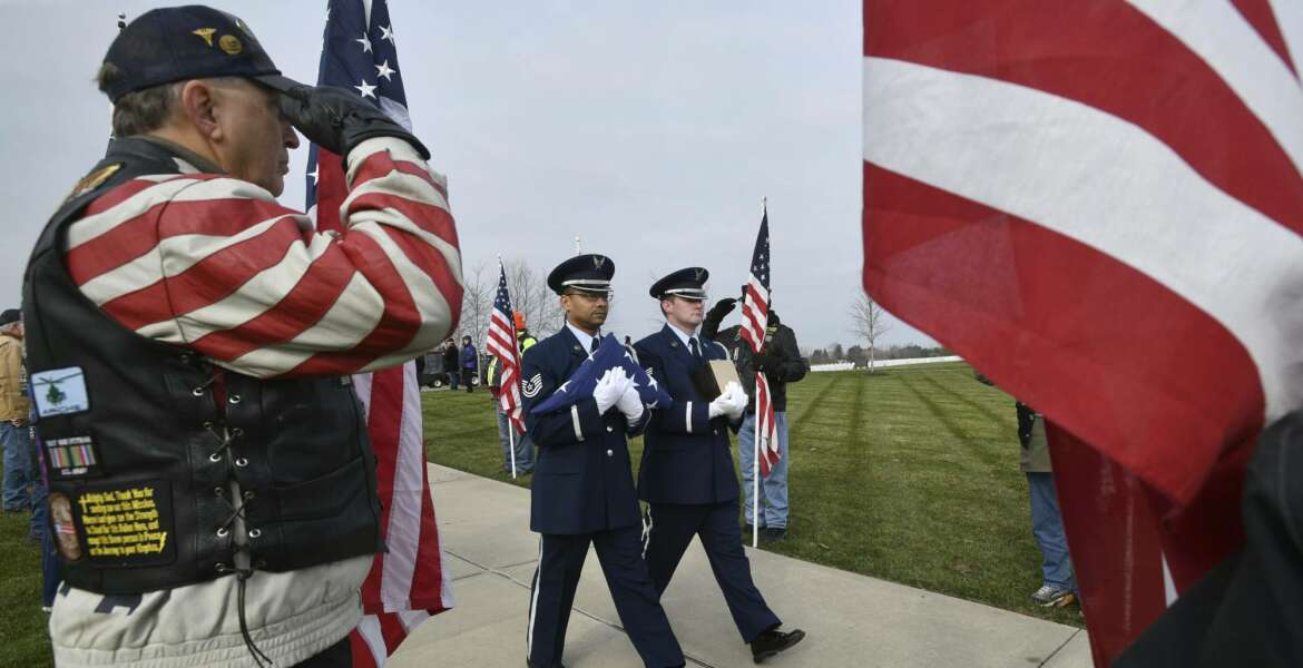 Honor guards from the US Air Force carry the creamated remains of veterans found at Cantrel Funeral home during a full military ceremony at the Great Lakes National Cemetery in Holly on Monday, Nov 12, 2018. About 20 Patriot Guard Riders lined the walk with flags for the ceremony. (Dale G.Young /Detroit News via AP)