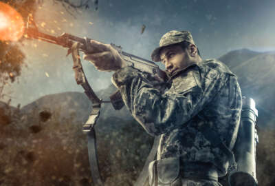 man in military gear shooting action with mountains on background game