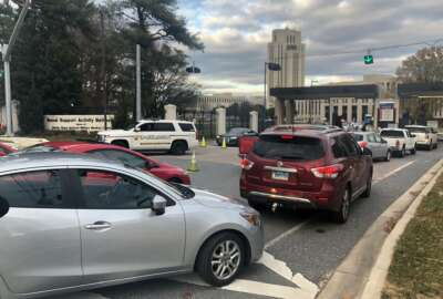 Cars are prevented from entering or exiting the Walter Reed National Military Medical Center, Tuesday, Nov. 27, 2018 in Bethesda, Md. Security officers found