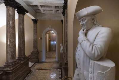 A statue of Benjamin Franklin is seen in an empty corridor outside the Senate at the Capitol in Washington, Thursday, Dec. 27, 2018, during a partial government shutdown. Chances look slim for ending the partial government shutdown any time soon. Lawmakers are away from Washington for the holidays and have been told they will get 24 hours' notice before having to return for a vote. (AP Photo/J. Scott Applewhite)