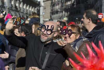 Revellers take selfies during a New Year's Eve rehearsal celebration in Madrid, Spain, Monday, Dec. 31, 2018. (AP Photo/Paul White)