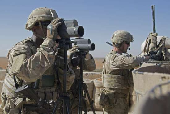 In this Nov. 1, 2018, photo released by the U.S. Army, soldiers surveil the area during a combined joint patrol in Manbij, Syria. The United States' main ally in Syria on Thursday, Dec. 20, 2018, rejected President Donald Trump's claim that Islamic State militants have been defeated and warned that the withdrawal of American troops would lead to a resurgence of the extremist group. (U.S. Army photo by Spc. Zoe Garbarino via AP)
