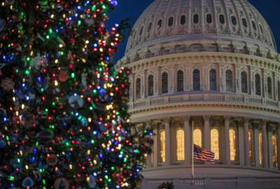 The Capitol is seen at twilight in Washington, Monday, Dec. 17, 2018. The fight over President Donald Trump's $5 billion wall funds deepened Monday, threatening a partial government shutdown in a standoff that has become increasingly common in Washington. (AP Photo/J. Scott Applewhite)