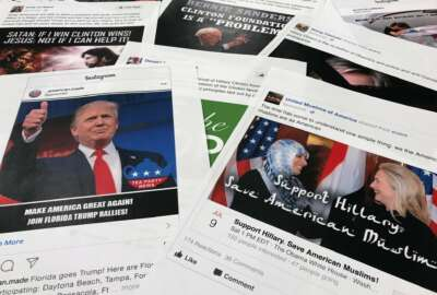Some of the Facebook and Instagram ads linked to a Russian effort to disrupt the American political process and stir up tensions around divisive social issues, released by members of the U.S. House Intelligence committee, are photographed in Washington, on Wednesday, Nov. 1, 2017.   A report compiled by private researchers and released by the Senate intelligence committee Monday says that
