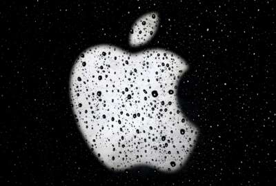 """FILE- In this Dec. 26, 2018, file photo an Apple logo is seen in raindrops on a window outside an Apple Store at the Country Club Plaza shopping district in Kansas City, Mo. Apple is reducing the size of its workforce assigned to driverless car technology as the company reorganizes amid weakening sales of iPhones, its biggest moneymaker. The company acknowledged the cutbacks in a Thursday, Jan. 24, 2019, statement, without specifying the number of jobs affected. CNBC reported that more than 200 employees were dismissed from Apple's self-driving car division, known internally as """"Project Titan."""" (AP Photo/Charlie Riedel, File)"""