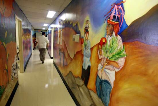 FILE - In this May 29, 2008, file photo, colorful murals line the walls at the Indian Health Services clinic at San Xavier Health complex just south of Tucson, Ariz. About 120,000 Arizona residents who receive Medicaid benefits will have to get a job, do community service or temporarily lose health coverage. The Centers for Medicare and Medicaid Services approved the state's plan Friday, Jan.18, 2019. The Trump administration has urged states to consider changes to their Medicaid programs to encourage work and independence. Others say it unfairly targets the working class. (Greg Bryan/Arizona Daily Star via AP, File)