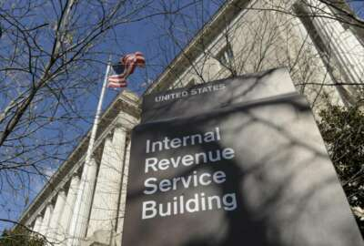 FILE - This March 22, 2013 file photo, shows the exterior of the Internal Revenue Service building in Washington. The Internal Revenue Service is recalling about 46,000 of its employees furloughed by the government shutdown, nearly 60 percent of its workforce, to handle tax returns and pay out refunds. The employees won't be paid. (AP Photo/Susan Walsh, File)