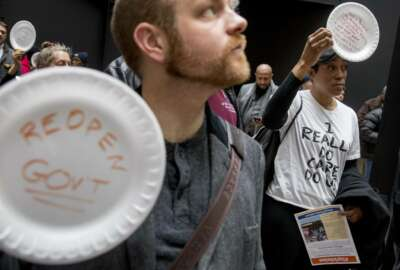 A furloughed government worker affected by the shutdown wears a shirt that reads