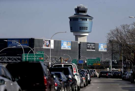 The air traffic control tower at LaGuardia Airport is seen, Friday, Jan. 25, 2019, in New York. The Federal Aviation Administration reported delays in air travel Friday because of a