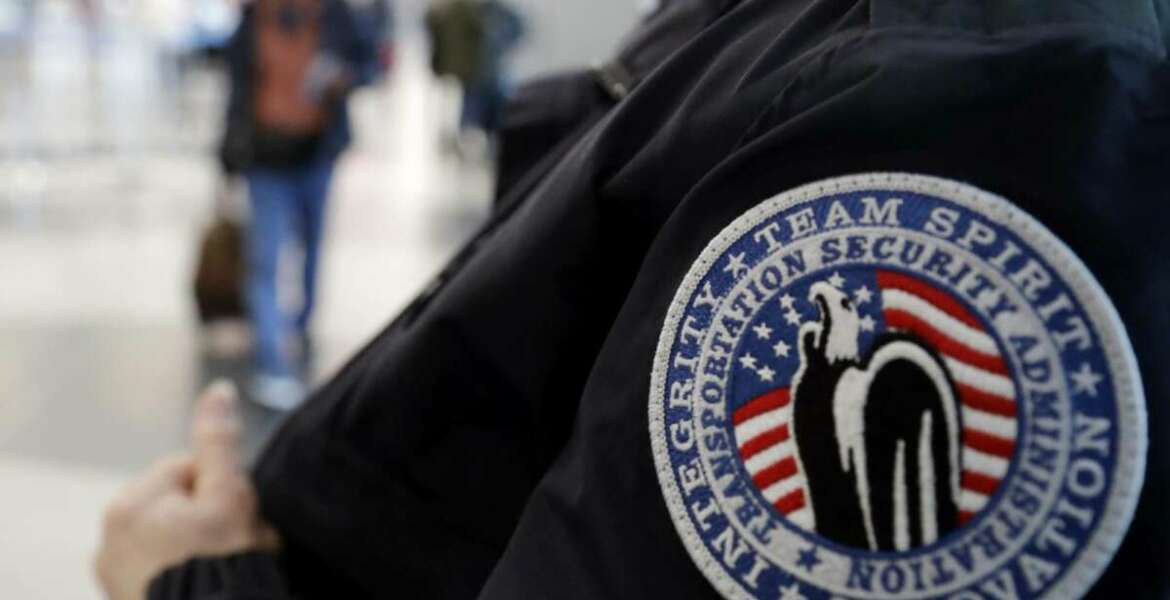 """FILE - In this Dec. 25, 2018 file photo, a TSA worker works at O'Hare International Airport in Chicago.  The federal agency tasked with guaranteeing U.S. airport security is acknowledging an increase in the number of its employees calling off work during the partial government shutdown. The Transportation Security Administration said in a Friday, Jan. 4, 2019  tweet that call outs that began over the holiday period are on the rise but the impact has been """"minimal."""" The agency said wait times may be affected but so far """"remain well within TSA standards."""" (AP Photo/Nam Y. Huh)"""