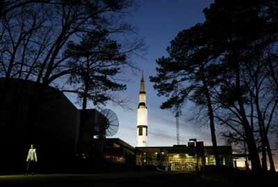 An employee leaves the state operated U.S. Space & Rocket Center which serves as the visitor center for the nearby federally funded NASA Marshall Space Flight Center, in Huntsville, Ala., Tuesday, Jan. 8, 2019. Once known for its cotton trade and watercress farms, Huntsville is the ultimate government town. About 70 federal agencies are located at the Army's sprawling Redstone Arsenal, and more than half the area economy is tied to Washington spending. (AP Photo/David Goldman)