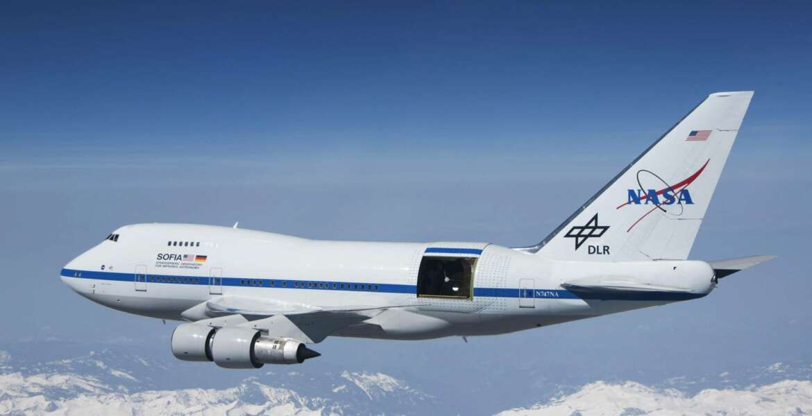 This undated photo provided by NASA shows SOFIA over the snow-covered Sierra Nevada mountains with its telescope door open during a test flight. The world's largest airborne observatory was supposed to be parked in Seattle this week, so thousands of scientists attending the