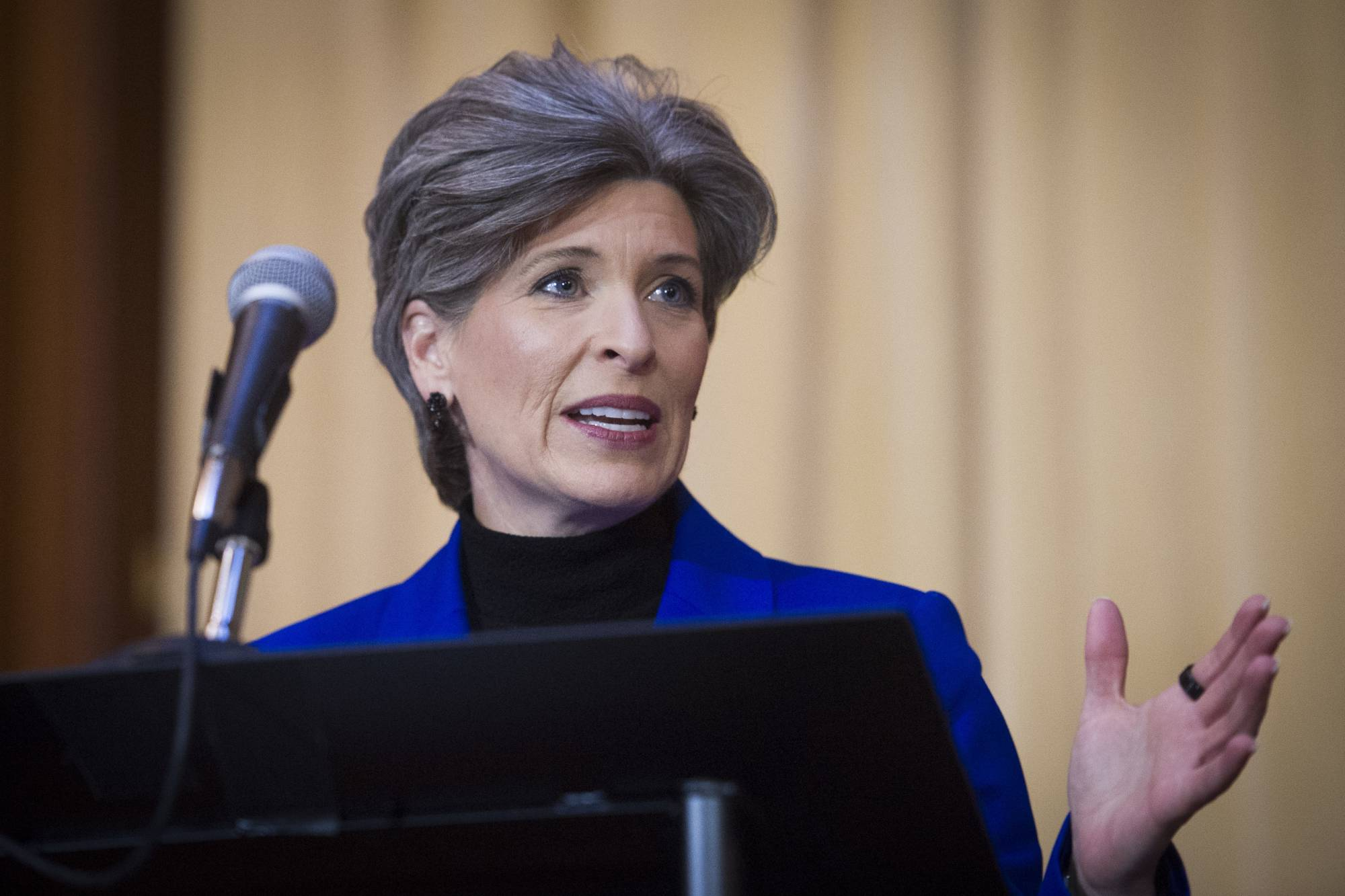 FILE - In this Dec. 11, 2018 file photo, Sen. Joni Ernst, R-Iowa, speaks during the signing of an order withdrawing federal protections for countless waterways and wetlands, at EPA headquarters in Washington. Ernst says she turned down Donald Trump's request to run as his vice president in 2016 because of family concerns. Ernst made the claim in an affidavit in a divorce proceeding in October that was first reported by CityView, a Des Moines weekly newspaper. The filing was unsealed earlier this month after Ernst and her former husband of 25 years, Gail Ernst, settled their previously contentious divorce. (AP Photo/Cliff Owen, File)