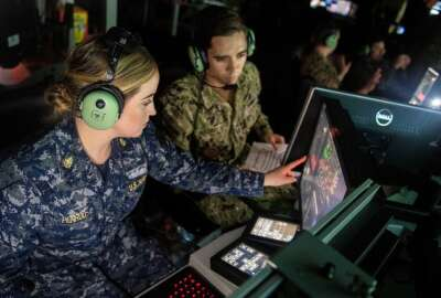 SAN DIEGO (Jan. 10, 2019) Chief Operations Specialist Anna Penrod, left, assigned to the guided-missile destroyer USS Rafael Peralta (DDG 115), and Lt. Aaron Van Driessche participate in an air defense scenario at the Combined Integrated Air and Missile Defense (IAMD) and Anti-Submarine Warfare (ASW) Trainer (CIAT). CIAT is the Navy's newest combat systems trainer. Rafael Peralta became the first warship to pilot the advance warfare training curriculum at CIAT. (U.S. Navy photo by Mass Communication Specialist 2nd Class Nicholas Burgains/Released)190110-N-AZ808-1033