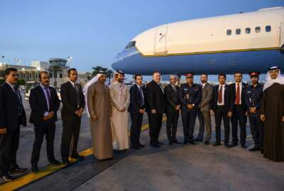U.S. Secretary of State Mike Pompeo, center, poses with his local security team before departing Manama International Airport in Manama, Bahrain, Friday, Jan. 11, 2019. (Andrew Caballero-Reynolds/Pool Photo via AP)