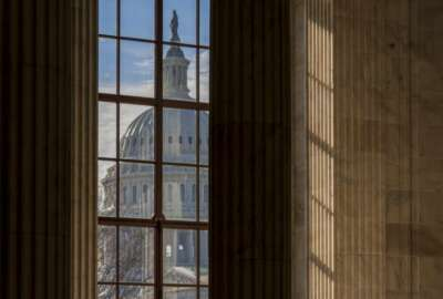 FILE- In this Dec. 27, 2018, file photo the Capitol Dome is seen from the Russell Senate Office Building in Washington during a partial government shutdown. On Thursday, Jan. 31, 2019, the Labor Department reports on the number of people who applied for unemployment benefits last week. (AP Photo/J. Scott Applewhite, File)