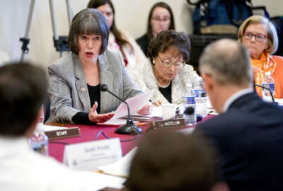 Rep. Betty McCollum, D-Minn., left, questions Environmental Protection Agency Administrator Scott Pruitt, foreground, as he testifies on the EPA FY2019 budget at a House Appropriations Subcommittee on Interior, Environment and Related Agencies on Capitol Hill in Washington, Thursday, April 26, 2018. (AP Photo/Andrew Harnik)
