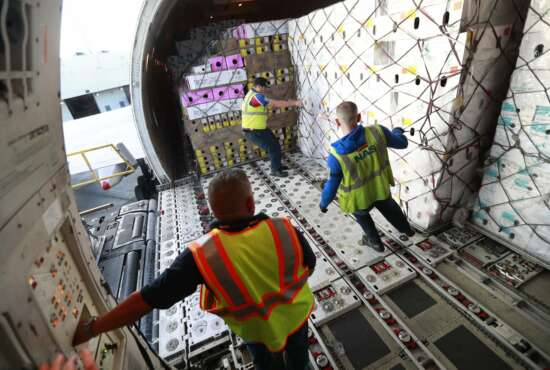 In this, Tuesday, Feb. 5, 2019 photo, workers unload boxes of flowers from a Boeing 747 cargo jet after arriving from Colombia, at Miami International Airport in Miami. According to U.S. Customs and Border Protection port director Christopher Maston, roughly 20 percent of the annual flower imports to Miami arrive just in the four weeks before Valentine's Day. The delicate cargo flies in on 95 to 100 daily flights, mostly from Colombia and Ecuador, compared with a dozen or so daily flights the rest of the year, according to Border Protection. (AP Photo/Wilfredo Lee)