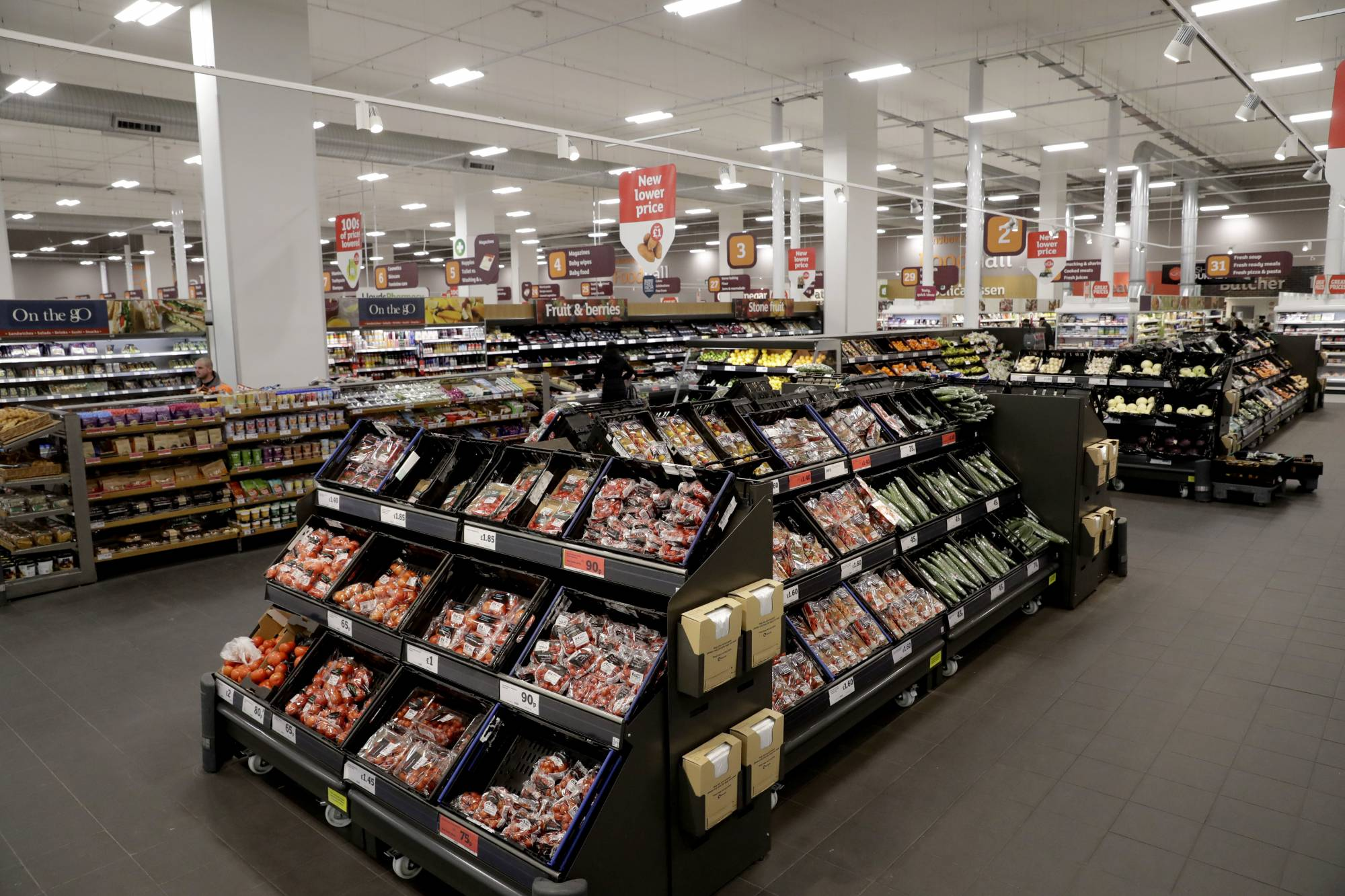 FILE- This April 30, 2018, file photo shows an interior view of the Sainsbury's flagship store in the Nine Elms area of London. British regulators say the proposed supermarkets merger between Sainsbury's and Walmart's Asda unit would push up prices and reduce quality for shoppers, casting doubt on a deal that would create the country's biggest grocery chain. (AP Photo/Matt Dunham, File)