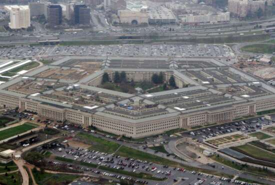FILE - This March 27, 2008, file aerial photo shows the Pentagon in Washington. The U.S. military wants to expand its use of artificial intelligence in warfare but says it will take care to deploy the technology in accordance with the nation's values. The Pentagon outlined its first AI strategy on Tuesday, Feb. 12, 2019. (AP Photo/Charles Dharapak, File)
