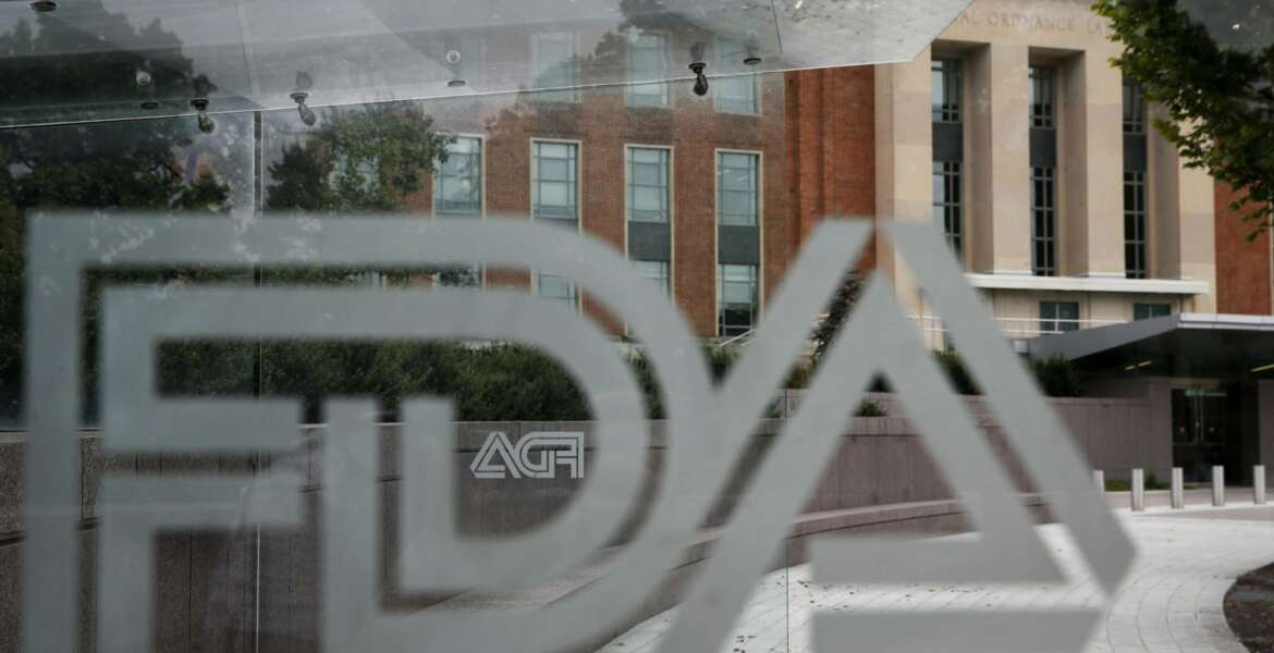 FILE - This Aug. 2, 2018 file photo shows the U.S. Food and Drug Administration building behind FDA logos at a bus stop on the agency's campus in Silver Spring, Md. The FDA announced plans Monday, Feb. 11, 2019, to step up its policing of dietary supplements, which it said has mushroomed into a $40 billion industry with more than 50,000 products. (AP Photo/Jacquelyn Martin)