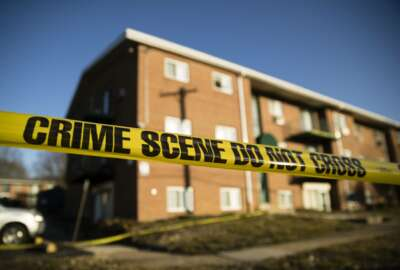 Crime scene tape surrounds the Robert Morris Apartments in Morrisville, Pa., Tuesday, Feb. 26, 2019. A woman and her teenage daughter are facing homicide charges in the deaths of multiple relatives, including children, inside an apartment at the complex in suburban Philadelphia, according to authorities. (AP Photo/Matt Rourke)
