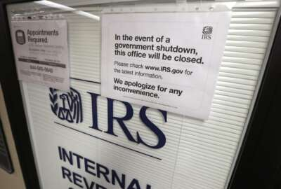 "FILE- In this Jan. 16, 2019, file photo doors at the Internal Revenue Service (IRS) in the Henry M. Jackson Federal Building are locked and covered with blinds as a sign posted advises that the office will be closed during the partial government shutdown in Seattle. Disruptions from last month's partial government shutdown caused a ""shocking"" deterioration in the IRS' telephone help for taxpayers in the first week of the filing season, the agency's watchdog said in a report released Tuesday, Feb. 12. (AP Photo/Elaine Thompson, File)"