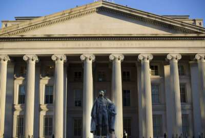 FILE - This June 8, 2017, file photo shows the U.S. Treasury Department building in Washington. The national debt has passed a new milestone, topping $22 trillion for the first time. The Treasury Department's daily statement shows that total outstanding public debt stands at $22.01 trillion. It stood at $19.95 trillion when President Donald Trump took office on Jan. 20, 2017. (AP Photo/Pablo Martinez Monsivais, File)