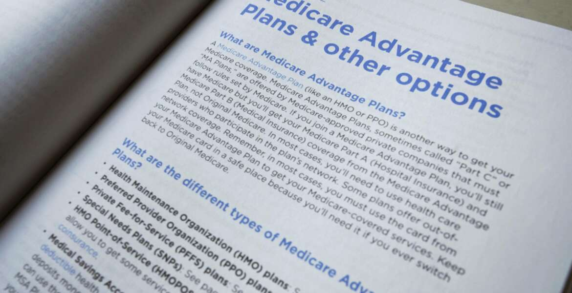 FILE - This Thursday, Nov. 8, 2018 file photo shows a page from the 2019 U.S. Medicare Handbook in Washington. Medicare Advantage enrollees get a new, second chance to find the right health coverage for 2019. The government added another enrollment window that started Jan. 1 and lasts until March 31. (AP Photo/Pablo Martinez Monsivais)