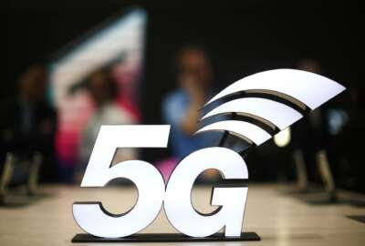 A banner of the 5G network is displayed during the Mobile World Congress wireless show, in Barcelona, Spain, Monday, Feb. 25, 2019. The annual Mobile World Congress (MWC) runs from 25-28 February in Barcelona, where companies from all over the world gather to share new products. (AP Photo/Manu Fernandez)