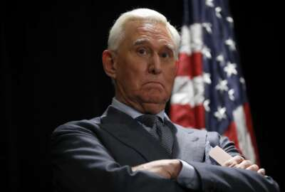 Roger Stone, longtime friend and confidant of President Donald Trump, waits to speak to members of the media in Washington, Thursday, Jan. 31, 2019. Stone is accused of lying to lawmakers, engaging in witness tampering and obstructing a congressional investigation into possible coordination between Russia and Trump's campaign. He pleaded not guilty this week. (AP Photo/Pablo Martinez Monsivais)