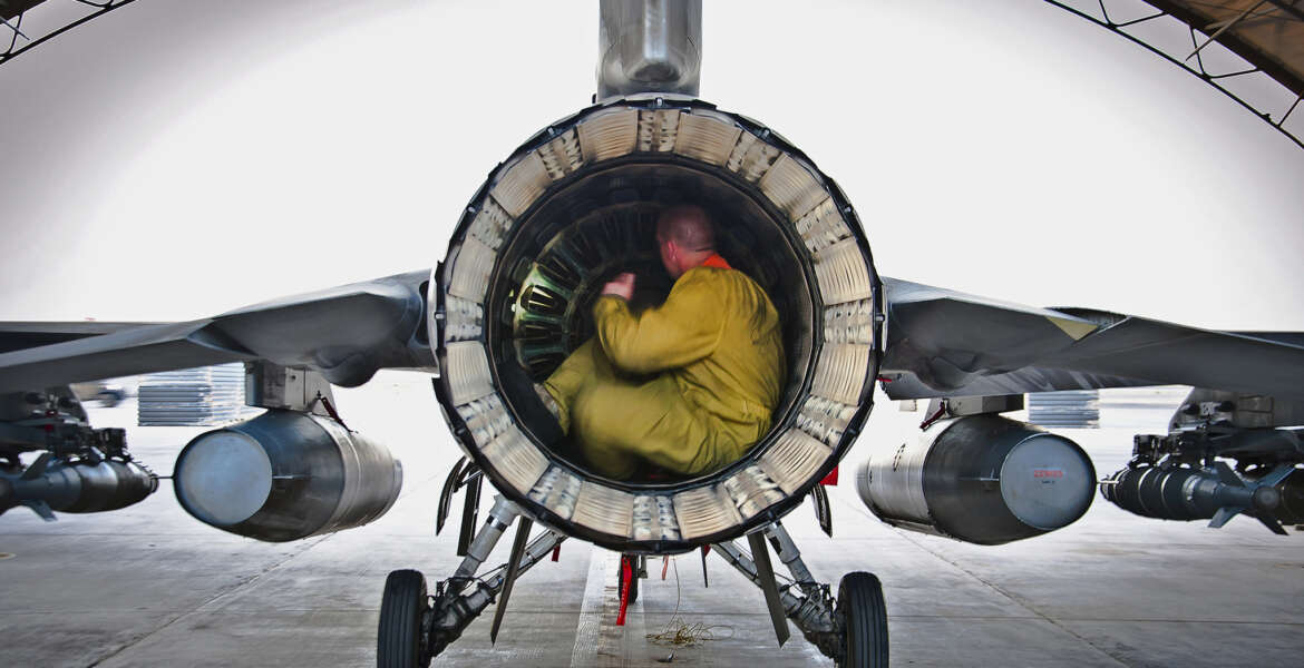 Senior Airman Nate Hall conducts a post-flight inspection on an F-16 Fighting Falcon July 5, 2013, at Kandahar Airfield, Afghanistan. Maintainers inspect aircraft for leaks, cracks or anything that may jeopardize the integrity of the aircraft. Hall is an aircraft maintainer deployed to the 451st Expeditionary Aircraft Maintenance Squadron.