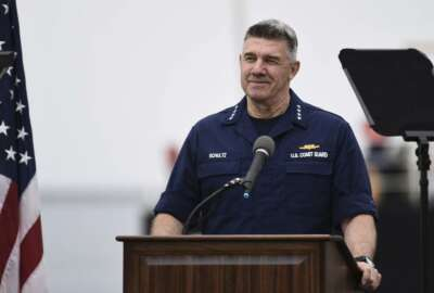 Adm. Karl Schultz, Coast Guard commandant, delivers the 2019 State of the Coast Guard Address at Coast Guard Base Los Angeles-Long Beach in San Pedro, Calif., Thursday, March 21, 2019. Strapped with an aging fleet, the U.S. Coast Guard is about to award a contract for a much-needed new icebreaker to help compete against Russia and China for a presence in the Arctic, but the service needs more funding for operations and infrastructure, its commandant said Thursday. (Seaman Ryan Estrada/U.S. Coast Guard via AP)