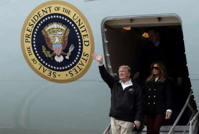 President Donald Trump and first lady Melania Trump arrive on Air Force One at Lawson Army Airfield, Fort Benning, Ga., Friday, March 8, 2019, en route to Lee County, Ala., where tornados killed 23 people. (AP Photo/Carolyn Kaster)