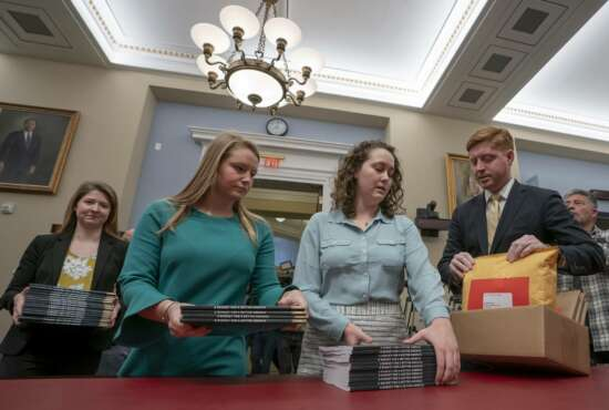Office of Management and Budget staff delivers President Donald Trump's 2020 budget to the House Budget Committee on Capitol Hill in Washington, Monday, March 11, 2019. Trump's new budget calls for billions more for his border wall, with steep cuts in domestic programs but increases for military spending. (AP Photo/J. Scott Applewhite)