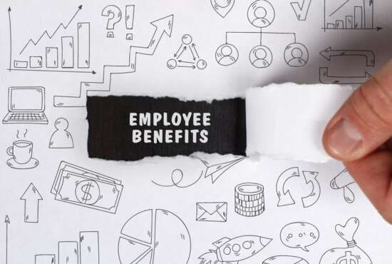 Business, Technology, Internet and network concept. Young businessman shows the word: Employee benefits
