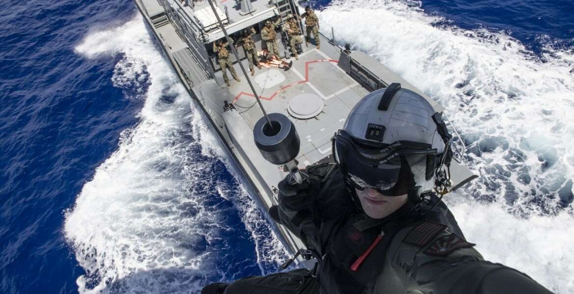 SANTA RITA, Guam (May 8, 2019) Naval Air Crewman (Helicopter) 2nd Class Nathan Swartz, from Elmhurst, Ill., is lowered to a Mark VI patrol boat assigned to Coastal Riverine Squadron (CRS) 2, from an MH-60S Sea Hawk helicopter assigned to the