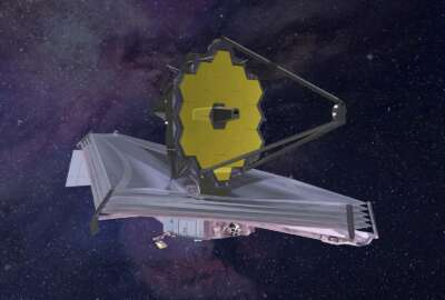 FILE - This 2015 artist's rendering provided by Northrop Grumman via NASA shows the James Webb Space Telescope. On Thursday, May 30, 2019, the U.S. Government Accountability Office reported that NASA's major projects are more than 27 percent over baseline costs and the average launch delay is 13 months. That's the largest schedule delay since the GAO began assessing NASA's major projects 10 years ago. The still-in-development James Webb Space Telescope is the major offender. (Northrop Grumman/NASA via AP)