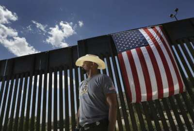 David Clarke Jr., a We Build the Wall Inc. board member, stands by a privately funded barrier, who arrived for a news conference in Sunland Park, N.M., Thursday, May 30, 2019. The New Mexico city is allowing construction to resume of the privately funded barrier along the U.S.-Mexico border following questions about its permit. (Mark Lambie/The El Paso Times via AP)