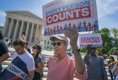 FILE - In this April 23, 2019 file photo, Immigration activists rally outside the Supreme Court as the justices hear arguments over the Trump administration's plan to ask about citizenship on the 2020 census, in Washington.  Voting rights activists argue that newly discovered 2015 correspondence between a GOP redistricting expert and a current Census Bureau official bolster arguments that discrimination motivated efforts to add a citizenship question to the 2020 population survey.  The plaintiffs, who successfully challenged the question in a Maryland federal court, said in a filing late Friday, June 14 that the email exchange between the late Republican consultant Thomas Hofeller and the Census Bureau official was discovered earlier this week. (AP Photo/J. Scott Applewhite)