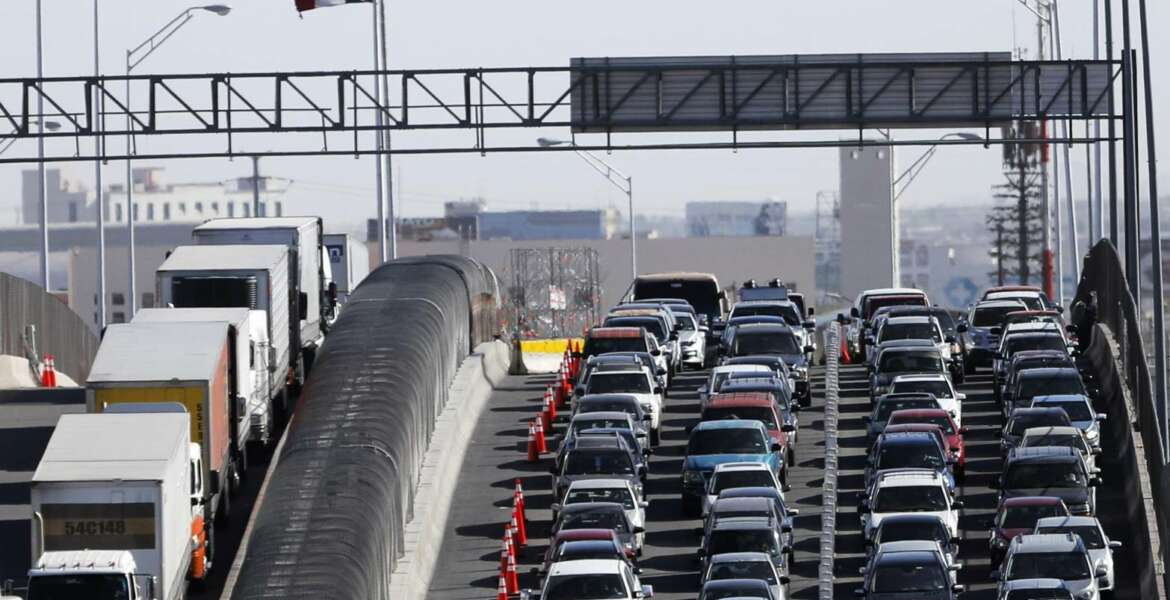 FILE - In this March 29, 2019, file photo, vehicles line up to enter the U.S. from Mexico at a border crossing in El Paso, Texas. Customs and Border Protection said Monday, June 10, that photos of travelers and license plates collected at a single U.S. border point have been exposed in a malicious cyberattack in what a leading congressman called a