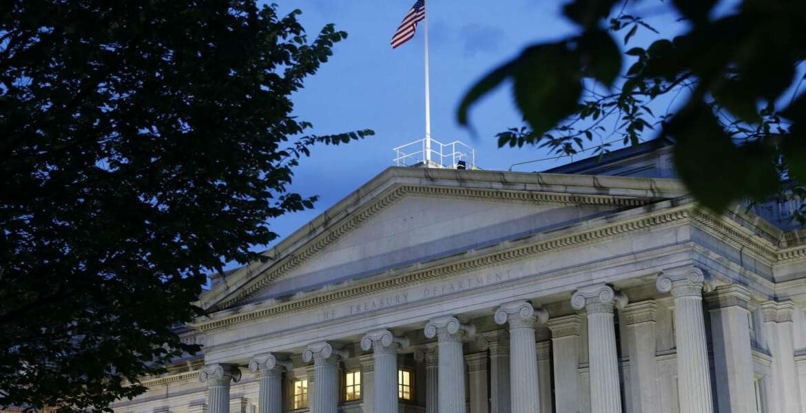 This Thursday, June 6, 2019, photo shows the U.S. Treasury Department building at dusk, in Washington. The Treasury Department issued final rules Tuesday, June 11 that would clamp down on taxpayers trying to circumvent a new cap on state and local tax deductions. (AP Photo/Patrick Semansky)