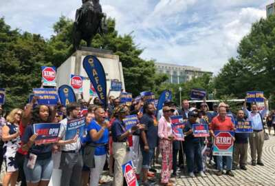 Members of the American Federation of Government Employees on Tuesday protested against the Trump administration's proposed OPM-GSA merger. (Nicole Ogrysko/Federal News Network)