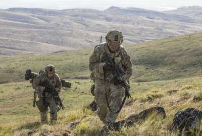 Pfc. Michael Roberts and Pvt. Nicholas Brown, cavalry scouts for Charlie Troop, 1st Squadron, 82nd Cavalry Regiment navigate rough eastern Washington terrain on foot while conducting dismounted zone reconnaissance training at the Yakima Training Center in Yakima, Wash., June 25, 2019. The training is part of a large-scale exercise known as eXportable Combat Training Capability (XCTC), which focuses on improving individual and team skillsets, decision making, equipment familiarization, and deployment readiness. (U.S. Army Photo by Sgt. Jennifer Lena, 115th Mobile Public Affairs Detachment)