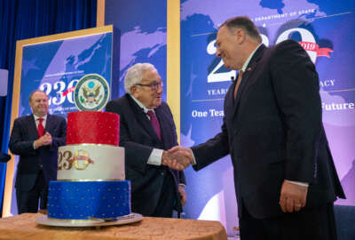 U.S. Secretary of State Michael R. Pompeo shake hands with former Secretary of State Dr. Henry Kissinger at the Department's 230th anniversary celebration at the U.S. Department of State in Washington, D.C., on July 29, 2019. [State Department photo by Ron Przysucha/Public Domain]
