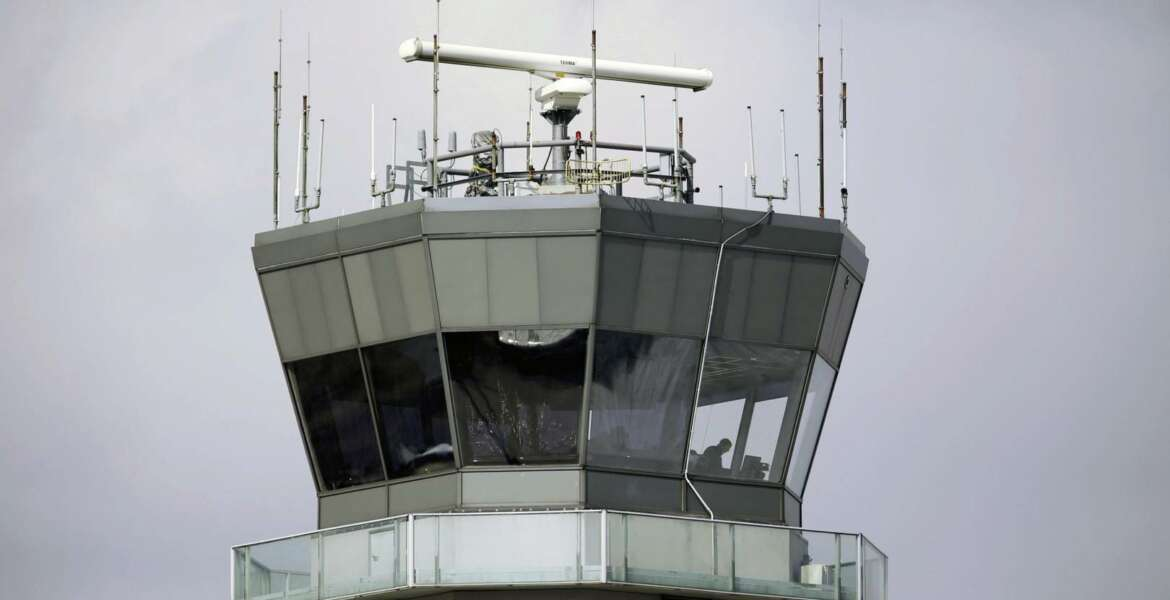 FILE - This March 12, 2013 photo shows the air traffic control tower at Chicago's Midway International Airport.  The Department of Homeland Security plans to issue a security alert Tuesday for small planes, warning that modern flight systems are vulnerable to hacking if someone manages to gain physical access to the aircraft. A DHS alert recommends that plane owners ensure they restrict unauthorized physical access to their aircraft until the industry develops safeguards to address the issue, which was discovered by Boston-based cybersecurity company, Rapid7, and reported to the federal government.  (AP Photo/M. Spencer Green)
