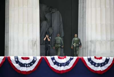 Police from various agencies work at the Lincoln Memorial as Fourth of July festivities are set up nearby, Wednesday, July 3, 2019, in Washington. (AP Photo/Jacquelyn Martin)