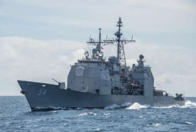 FILE - This March 6, 2016, photo provided by the U.S. Navy, shows the Ticonderoga-class guided-missile cruiser USS Antietam (CG 54) sails in the South China Sea. Taiwan says the U.S. Navy is free to sail through its strait after an American warship did so shortly following warnings from Beijing against foreign interference in its relationship with the island. Commander Clay Doss, a spokesman for the U.S. Navy's Seventh Fleet, said the
