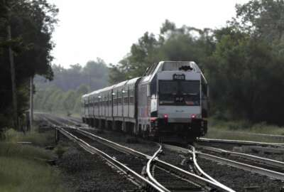 """FILE- This Aug. 3, 2018, file photo shows a New Jersey Transit train leaving the Bound Brook Station in Bound Brook, N.J. Federal railway officials say the railroad industry has installed safety technology on nearly 90 percent of tracks where it is required, but """"significant work"""" is needed to ensure the technology is completely installed by a December 2020 deadline. (AP Photo/Julio Cortez, File)"""